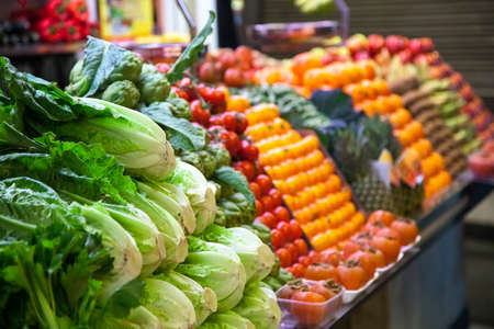 sweet stuff: Marketplace with vegetables in Barcelona market, Spain Stock Photo