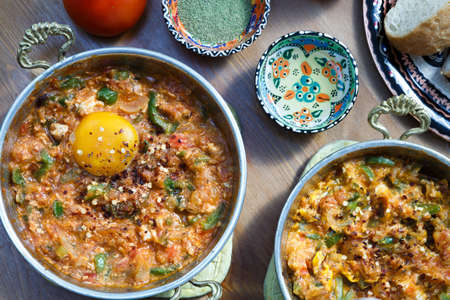 breakfast food: Menemen Turkish breakfast food egg, tomatoes and pepper in pan with concept background Stock Photo