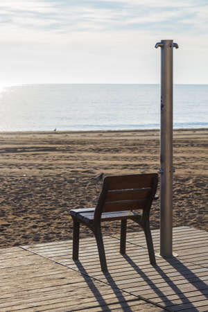 beach front: Bench on beach front in Barcelonetta, Barcelona Stock Photo