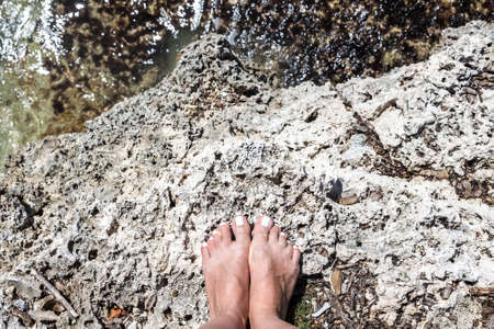 bare girl: Woman bare feet stand on stone, view from top