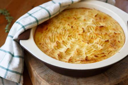 shepards: homade Shepherds Pie in the casserole dish. Stock Photo
