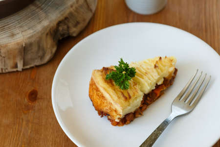 shepards: Shepards Pie With A Fork and tea Stock Photo