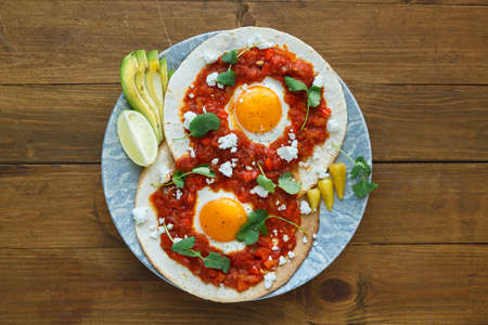 huevos rancheros closeup on the table, horizontal view from above.