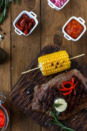 black angus: Grilled Black Angus Steak on wooden background. Top view