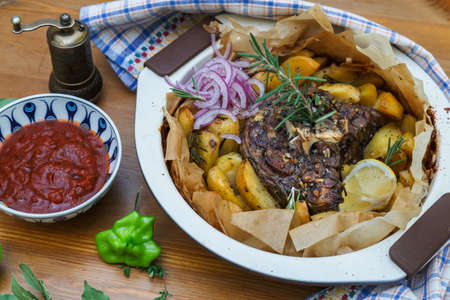 roast potatoes: Traditional Greek kleftiko, an oven-baked lamb stew with mizithra cheese, olive oil, onion, carrot, garlic and herbs, served with lemon roast potatoes.