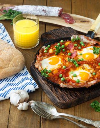 andalusian cuisine: flamenco eggs, huevos a la flamenca, spanish andalusian cuisine.