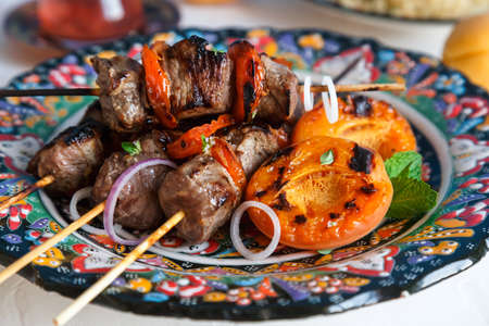 cubed: Lamb kebab marinated with yoghurt with apricots served on traditional plate, arabian style Stock Photo