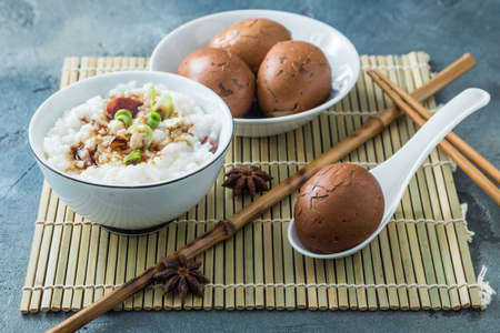 Tea eggs with rice porrige, chinese breakfast.