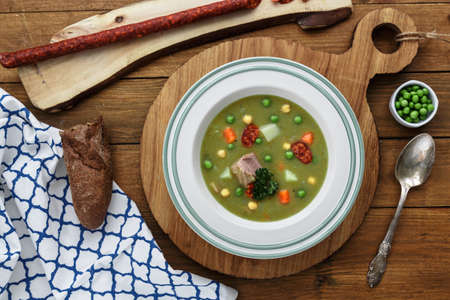 smoked sausage: Hearty traditional Dutch pea soup with smoked sausage, rye bread and bacon. Or: erwtensoep met rookworst, roggebrood en spek