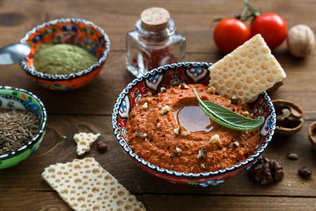 Muhammara traditional Arabian appetizer on the table close-up. vertical