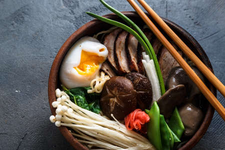 Mixed oriental mushroom stir fry with noodles soup and spring onion Stock Photo