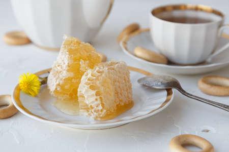 Tea with honey on white background Stock Photo