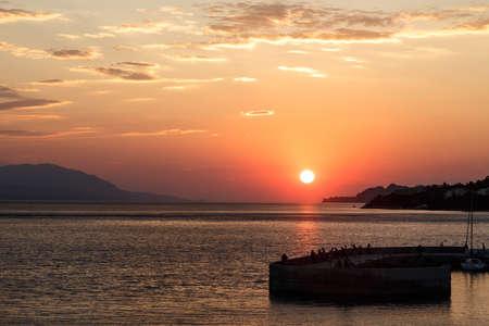 Beautiful sunset with sea and pier, Loutraki, Grecee Stock Photo