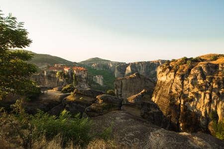 miraculous: First sun rays on the Holy Monastery of Varlaam on the edge of high rock. Kalambaka, Greece.