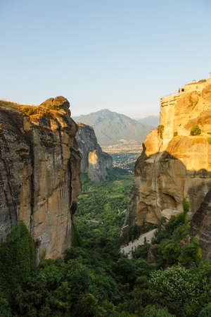 cloister: landscape of meteora in the morning with monastery on top of the mountain, Greece