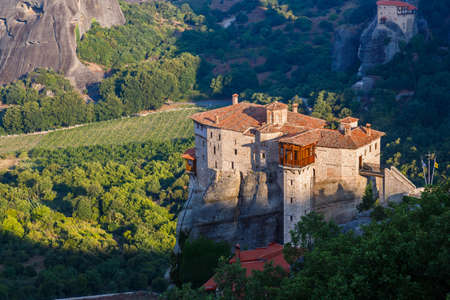 Sunlight over monastery Roussanou in the morning on top of the mountain, Meteora, Greece