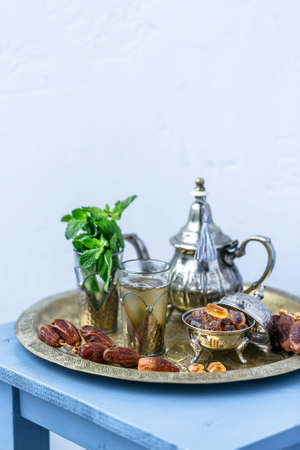 Traditional Moroccan mint tea on white background, selected focus Stock Photo