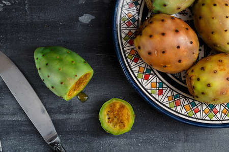 Cutted opuntia or prickly pear on dark background