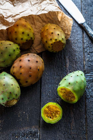 Colorful cactus fruit or prickly pears in paper package Stock Photo