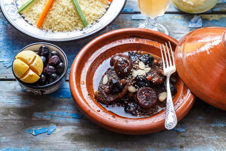 Traditional moroccan tajine of beef and prunes and almonds, close view. Stock Photo