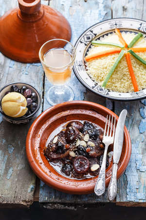 Beef tajine with olives, couscous and salted lemons. Morrocan dishes.