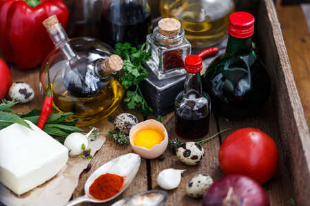 Various spices, oils and sauces selection on wooden background. Stock Photo