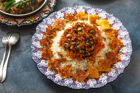 Jeweled rice or shirin polo in traditional plate Imagens