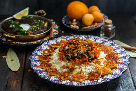 Iranian sweet rice with orange zest, nuts and dried fruits, shirin polo Stock Photo