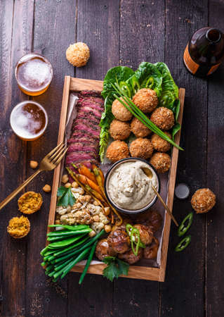 Assorted middle eastern dishes: falafel, meat, potato, cauliflower and babaghanoush Stock Photo