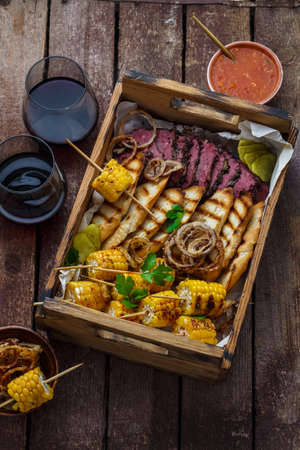 Box loaded with pastrami and corn Stock Photo