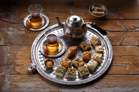 Traditional Turkish tea with oriental sweets, rustic copy space.