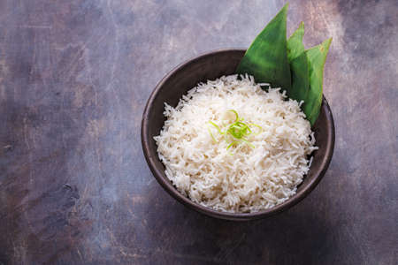 Nasi lemak or Malay fragrant rice cooked in coconut milk and pandan leaf, copy space