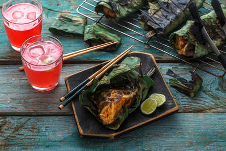 Grilled stingray wing or sambal stingray in leaf with lime and spicy dressing, malaysian cuisine Reklamní fotografie