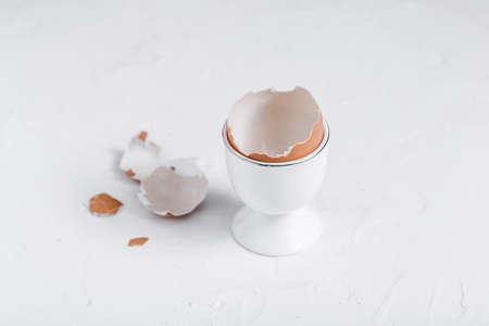 Empty eg shell or eaten eg on white background. copy space