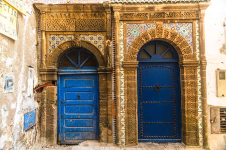 Ancient blue doors on the streets of Essaouira, Morocco.