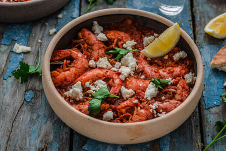 Prawn in tomato sauce with feta cheese, greek cuisine Imagens
