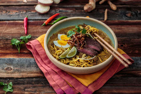 Malaysia Spicy Noodle Mee Rebus With Beef Egg and fried onion, copy space