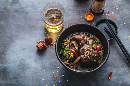 Asian lamb stew in a pot, top view copy space Imagens