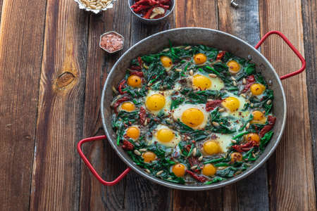 Turkish cuisine spinach with fried eggs or ispanak yumurta, copy space.