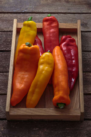Close view colorful peppers in wooden box. 写真素材