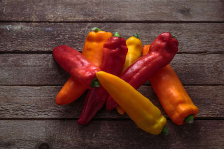 Ripe Colorful Ramiro Peppers on Rustic Wooden background. 写真素材