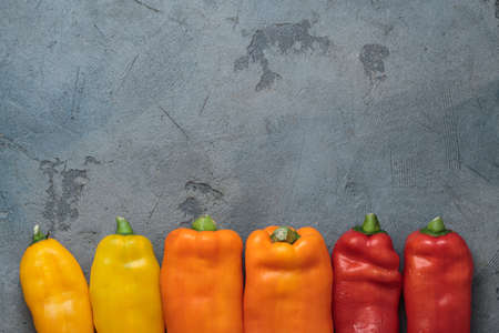 Ripe Colorful Ramiro Peppers on stone background, copy space.