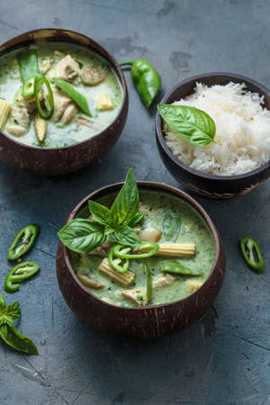 Green curry with chicken in a bowl, thai cuisine