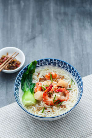 Hawker food bee hoon soup in traditional bowl, copy space 写真素材