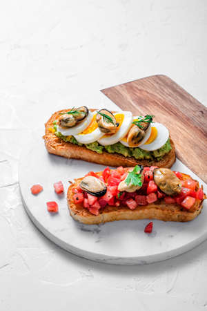 Bruschetta with mussels and tomatoes, copy space