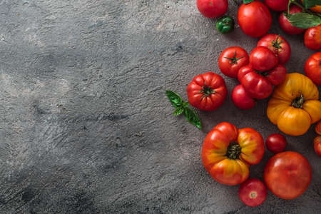 Fresh tomatoes on a concrete background. Top view with copy space. Zdjęcie Seryjne