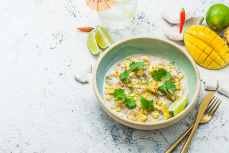 Raw scallops with mango and pineapple in coconut milk, thai style, copy space