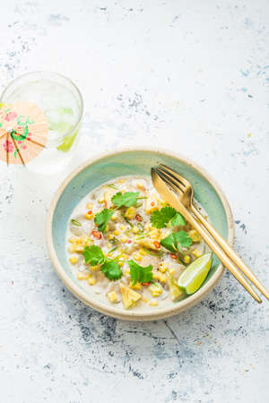 Scallops tartare with mango and pineapple in coconut milk, thai style, copy space Zdjęcie Seryjne