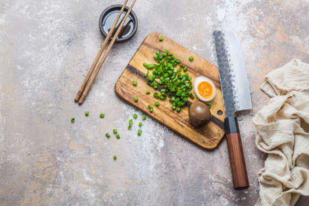 Ramen eggs on wooden cuting board with knife, copy space Zdjęcie Seryjne