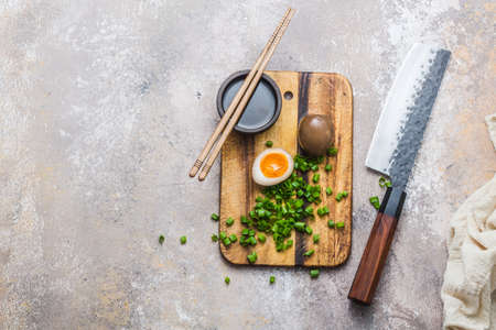 Marinated egg nitamago on cutting board, copy space